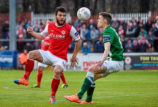 St Patrick's Athletic's James Chambers in action against Garry Buckley of Cork City. Photo: David Maher / SPORTSFILE