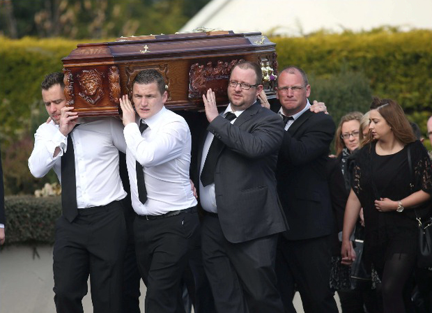 Familymembers carry the coffin of Anne Shorthall