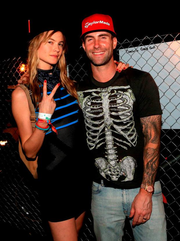 a87a24bcc9 Model Behati Prinsloo (L) and musician Adam Levine attend day 1 of the 2015
