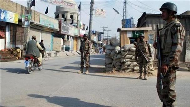 Pakistani paramilitary troops patrolling a street in Quetta, Balochistan Credit: Reuters