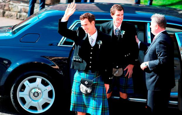 British tennis number one Andy Murray (left) and his brother Jamie Murray (second left) arrive for his wedding to his long-term girlfriend Kim Sears at Dunblane Cathedral
