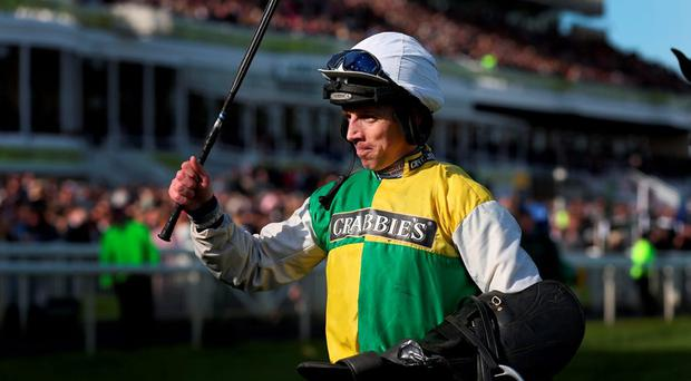 LIVERPOOL, ENGLAND - APRIL 11: Leighton Aspell celebrates after winning the 2015 Crabbie's Grand National on Many Clouds at Aintree Racecourse on April 11, 2015 in Liverpool, England. (Photo by Alex Livesey/Getty Images)