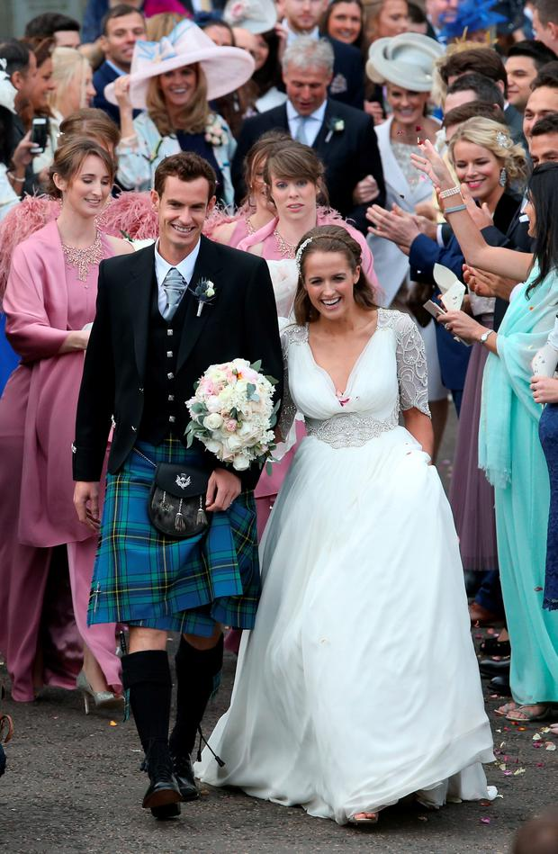 British tennis number one Andy Murray and Kim Sears after their wedding at Dunblane Cathedral. Andrew Milligan/PA Wire