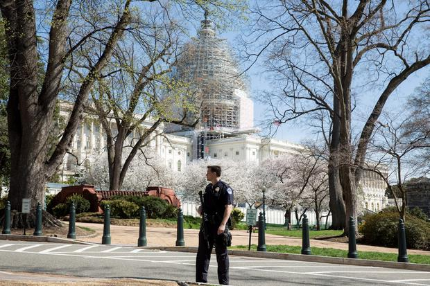 Police guard the U.S. Capitol grounds after a shooting took place, in Washington April 11, 2015. REUTERS/Joshua Roberts