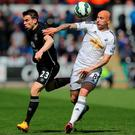 Seamus Coleman of Everton and Jonjo Shelvey of Swansea battle for the ball