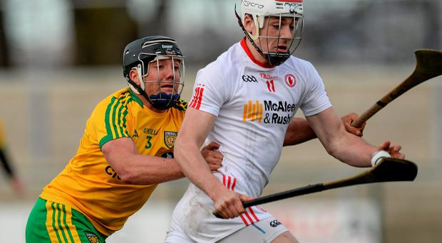 Damien Casey, Tyrone, in action against Jamsie Donnelly, Donegal