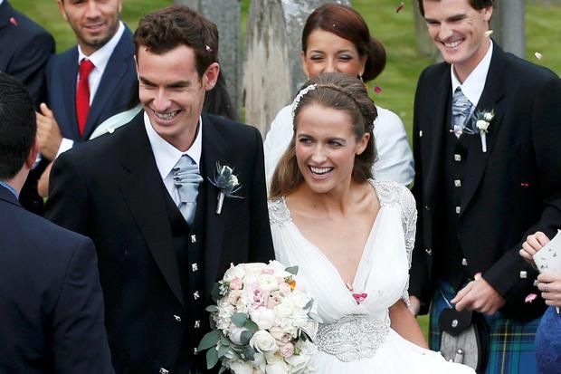 Andy Murray and his bride Kim Sears leave the church. Photo: Russell Cheyne