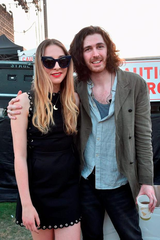 Musicians Este Haim of Haim (L) and Hozier attend day 2 of the 2015 Coachella Valley Music & Arts Festival (Weekend 1) at the Empire Polo Club on April 11, 2015 in Indio, California. (Photo by Kevin Winter/Getty Images)