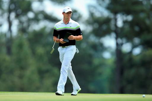 Rory McIlroy walks across the third green during the third round of the 2015 Masters Tournament at Augusta National Golf Club