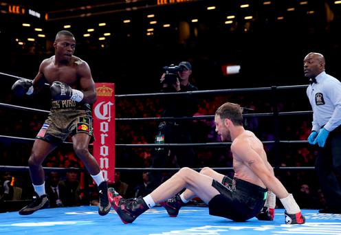 Peter Quillin knocks down Andy Lee during the Premier Boxing Champions Middleweight