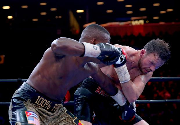 Andy Lee and Peter Quillin exchange punches during the Premier Boxing Champions Middleweight bout