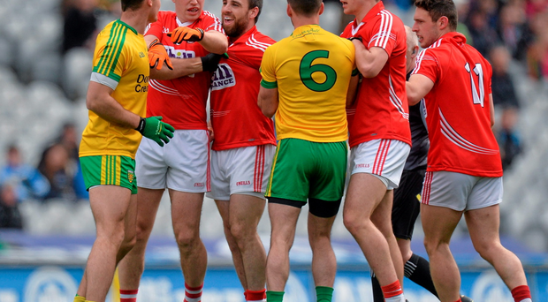 Donegal and Cork players in a tussle during the second half.