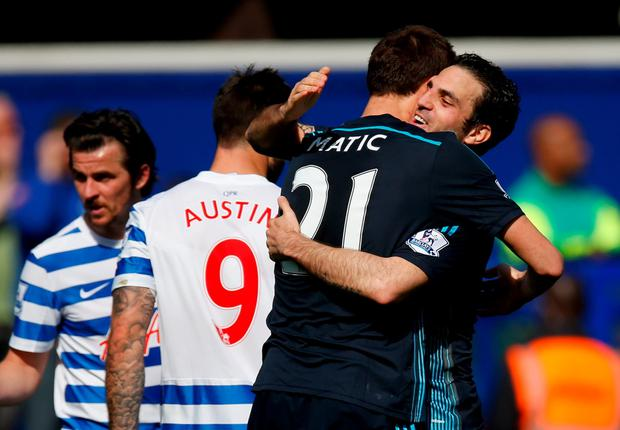 Cesc Fabregas celebrates victory with Nemanja Matic of Chelsea at Loftus Road