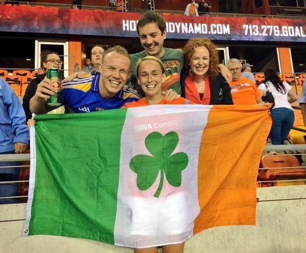 Stephanie Roche poses with Paul McEvoy (left) and fans after the game