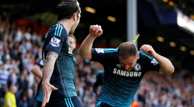 Branislav Ivanovic is hit by a lighter thrown from the crowd during the Chelsea v QPR match yesterday REUTERS