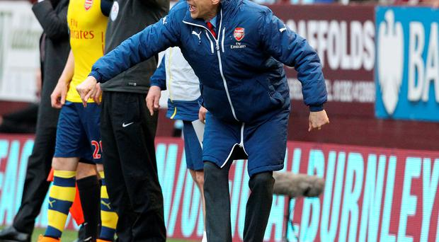 Arsene Wenger shouts at his players during their clash with Burnley at Turf Moor