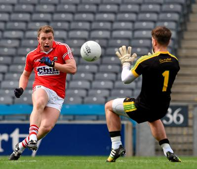 Brian Hurley shoots past the Donegal goalkeeper Michael Boyle to score Cork's third goal in their Allianz FL semi-final