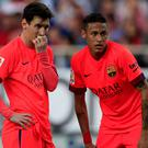 Neymar (right) set up Lionel Messi for Barca's first goal and the Brazilian then converted an inch-perfect free kick after 31 minutes but a determined Sevilla, who are unbeaten in 32 home games, never gave up.