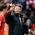 Manchester United manager Louis van Gaal celebrates with Ander Herrera (left) after the final whistle