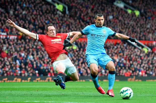 Phil Jones challenges Sergio Aguero during Manchester United's victory at Old Trafford
