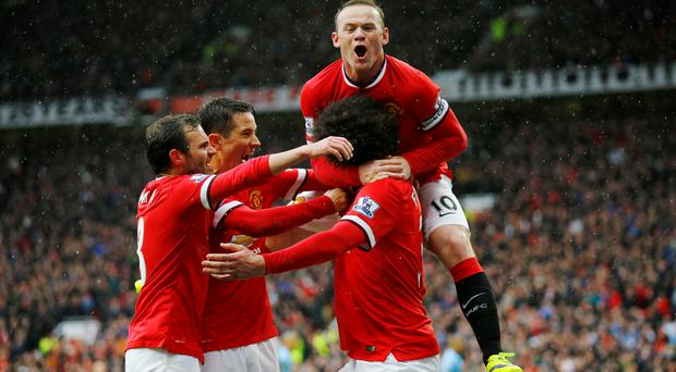 Wayne Rooney shows his delight after Marouane Fellaini's goal during Manchester United's victory against Manchester City at Old Trafford