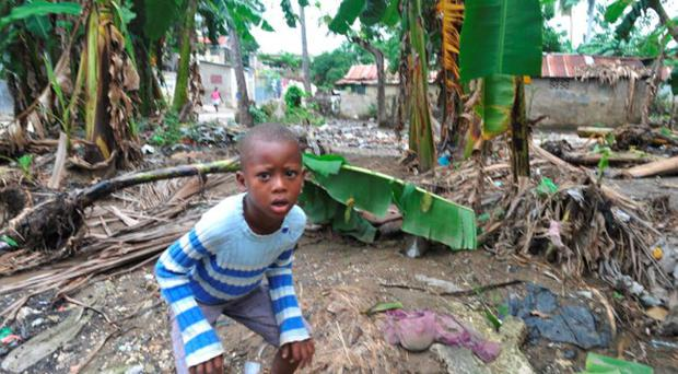 A young boy stands amid damage done by Hurricane Sandy, November 17, 2012 in the Nippes section of Haiti (Getty Images)