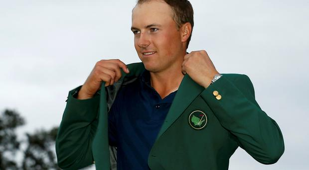 2015 Masters Champion Jordan Spieth of the U.S. wears his Champion's green jacket on the putting green after winning the Masters golf tournament at the Augusta National Golf Course in Augusta, Georgia April 12, 2015. REUTERS/Jim Young