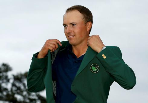 2015 Masters Champion Jordan Spieth of the U.S. wears his Champion's green jacket on the putting green after winning the Masters golf tournament at the Augusta National Golf Course