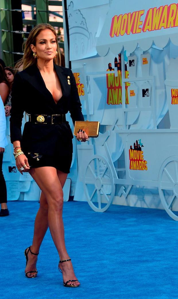 Singer/actress Jennifer Lopez poses on arrival for the 2015 MTV Movie Awards