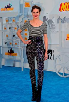 Actress Shailene Woodley poses on arrival for the 2015 MTV Movie Awards