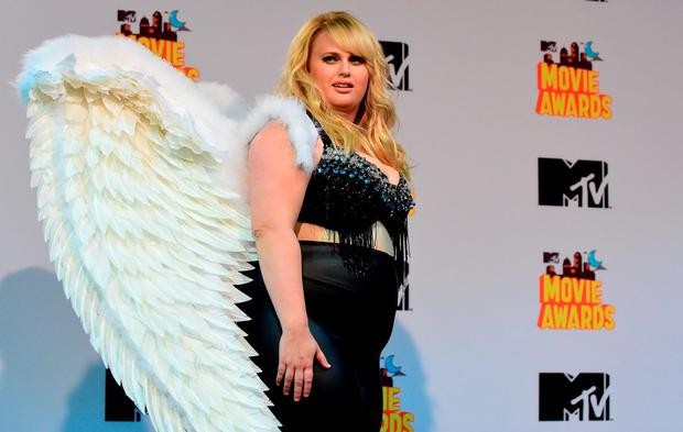 Actress Rebel Wilson poses for a photo in the press room during the 2015 MTV Movie Awards
