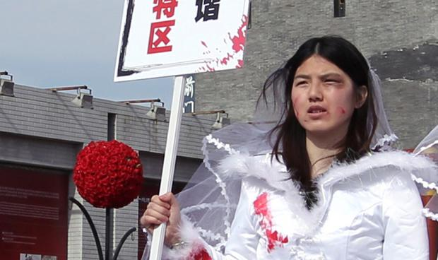 Li Tingting campaigning against domestic violence in 2012 Credit: Simon Song