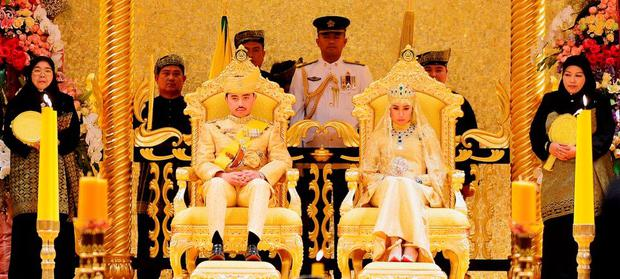 Brunei's newly wed royal couple, Prince Abdul Malik and Dayangku Raabi'atul 'Adawiyyah Pengiran Haji Bolkiah, sit during the