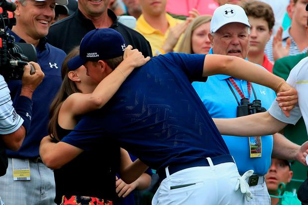 Jordan Spieth of the United States is greeted by his girlfriend Annie Verret behind the 18th green after Spieth's four-stroke victory at the 2015 Masters Tournament at Augusta National Golf Club