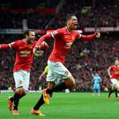 Chris Smalling celebrates scoring Manchester United's fourth goal against Manchester City at Old Trafford.