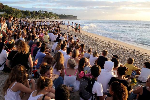 Large crowds gathered on the beach where Elio was killed to paid their respects Credit: Reuters