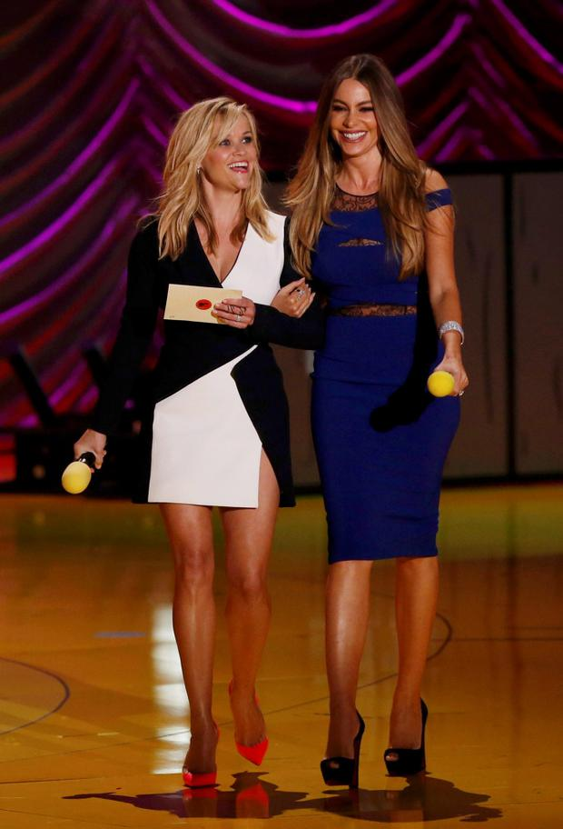 Actresses Reese Witherspoon (left) and Sofia Vergara walk onstage to present an award at the 2015 MTV Movie Awards in Los Angeles, California. Reuters/Mario Anzuoni