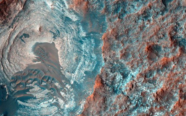 A circular depression on the surface of Mars is pictured in his image acquired on Jan. 5, 2015 by the High Resolution Imaging Science Experiment (HiRISE) camera on NASA's Mars Reconnaissance Orbiter (MRO), provided by NASA. Reuters/NASA/JPL-Caltech/University of Arizona/Handout