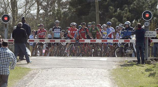 The barrier halts most of the riders
