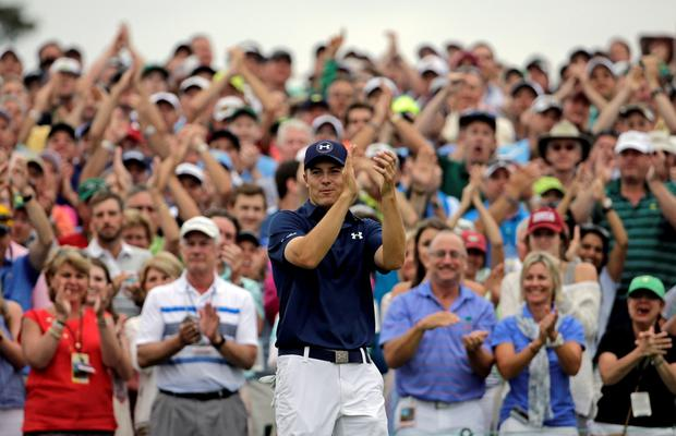Jordan Spieth applauds after winning the Masters championship during the fourth round of the Masters golf tournament Sunday, April 12, 2015, in Augusta, Ga. (AP Photo/David J. Phillip)