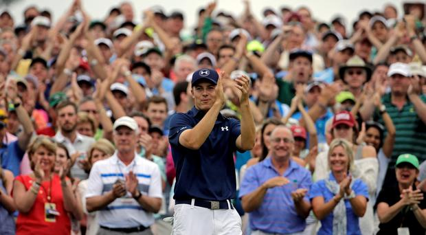 Jordan Spieth applauds after winning the Masters