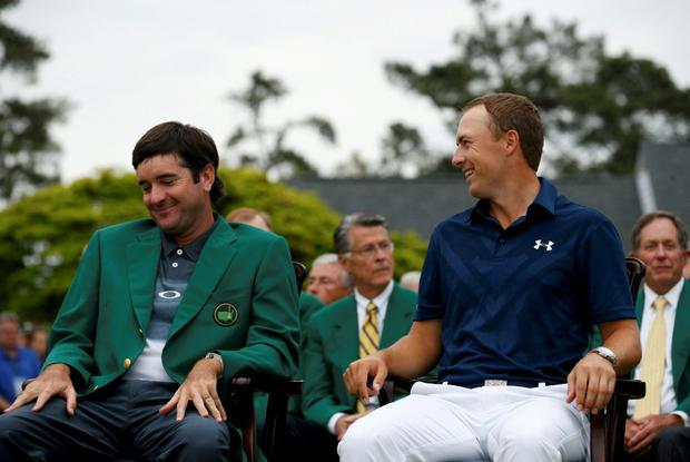 Jordan Spieth of the U.S. (R) shares a laugh with 2014 Masters Champion Bubba Watson before receiving his green jacket after winning the 2015 Masters golf tournament at the Augusta National Golf Course in Augusta, Georgia April 12, 2015. REUTERS/Jim Young