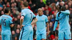 Manchester City's Sergio Aguero and Yaya Toure look dejected after Manchester United's first goal scored by Ashley Young (not pictured) Action Images via Reuters / Jason Cairnduff Livepic