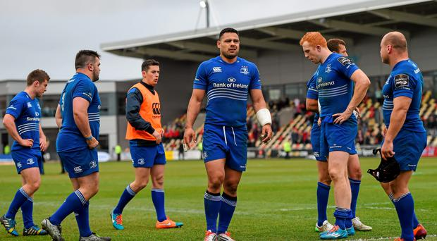 Leinster players including Ben Te'o (C) and Darragh Fanning look dejected after their defeat to the Dragons