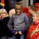 A Liverpool fan wearing a Mario Balotelli mask in the stands during the Barclays Premier League match at Anfield last night