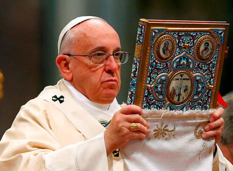 Pope Francis blesses the missal as he leads a mass on the 100th anniversary of the Armenian mass killings, in St. Peter's Basilica at the Vatican. Photo: Reuters