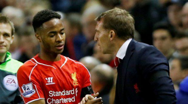 Liverpool's Raheem Sterling shakes hands with manager Brendan Rodgers after being substituted