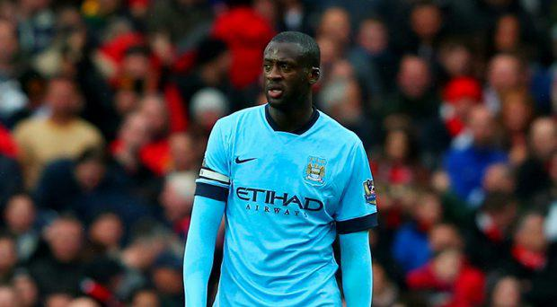Yaya Toure of Manchester City looks dejected during the Barclays Premier League match between Manchester United and Manchester City at Old Trafford
