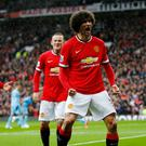 Marouane Fellaini celebrates scoring the second goal for Manchester United
