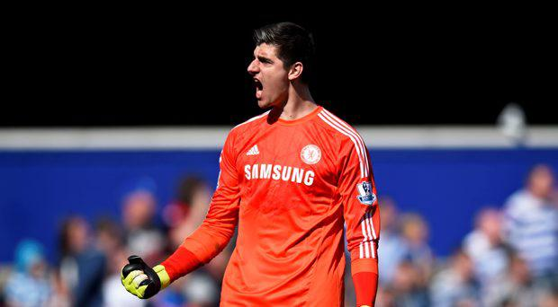 Chelsea's Thibaut Courtois celebrates after their first goal scored by Cesc Fabregas (not pictured)